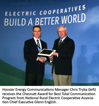 Hoosier Energy Communications Manager Chris Tryba (left) receives the Chesnutt Award for Best Total Communication Program from National Rural Electric Cooperative Association Chief Executive Glenn English.