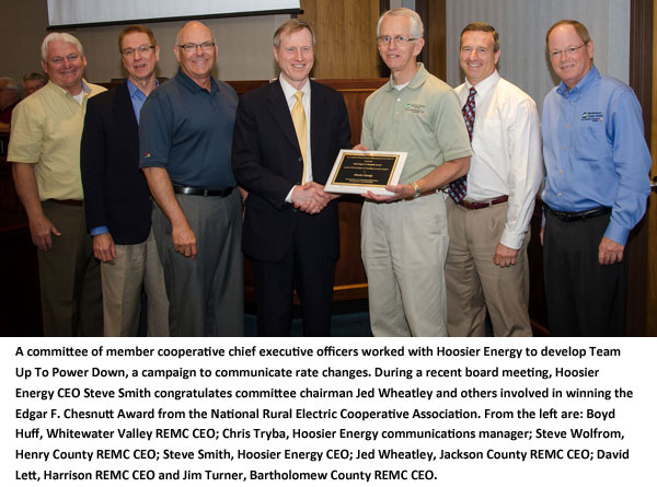During a recent board meeting, Hoosier Energy CEO Steve Smith congratulates committee chairman Jed Wheatley and others involved in winning the Edgar F. Chesnutt Award.